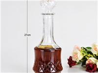玻璃酒瓶和瓷的酒瓶有什么本质的不同  玻璃酒瓶上的图案是如何印上去的