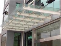 钢结构玻璃雨棚施工工艺  钢结构玻璃雨棚要多少钱 