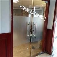 深圳龙岗黑钛金玻璃门办公室商场店铺玻璃门安装维修