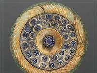 镶嵌玻璃,是中国发现较早的玻璃制品
